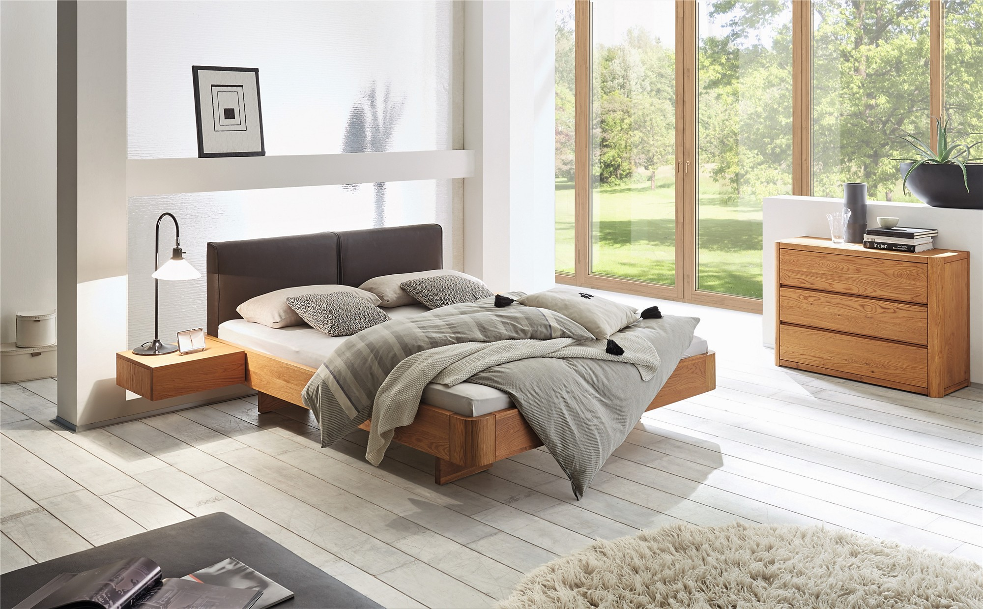 shown in natural oak oiled with cemoa headboard in terra dark brown leather with caja floating bedside tables